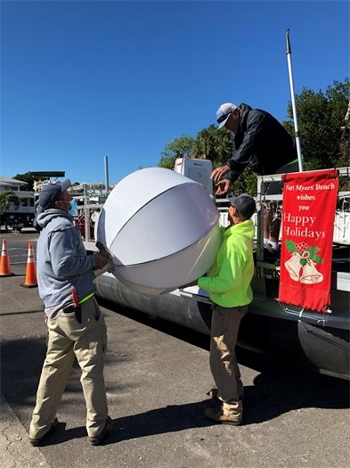 Members of the Public Works Department prepared the board for the FMB Chamber Parade on December 5